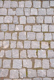 Gammal grå trottoar i en modell i en gammal medeltida europeisk stad Arkivbild