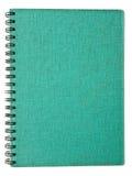 gammal grön anteckningsbok arkivfoto