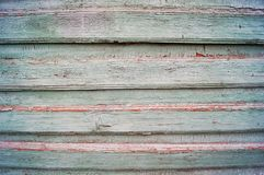 Gammal grön träplankavägg royaltyfri foto