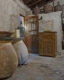 Gammal grekisk spritfabrik för ouzo (anice) royaltyfria foton