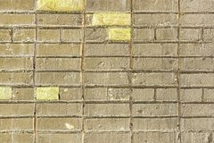 Gammal Grey Yellow Brick Wall Texture bakgrund royaltyfri bild