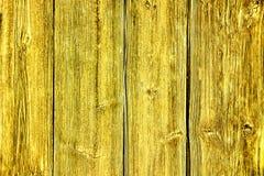 Gammal grunge och red ut gula träväggplankor texturerar bakgrund Arkivbild