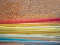 Gammal grungy textur, orange betongvägg Arkivfoto