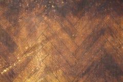 Gammal gul parkett med bruna smutsfläckar och skrapor Textur för grov yttersida fotografering för bildbyråer