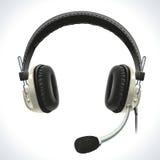 Gammal hörlurar med mikrofonen Arkivbild