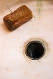 Gammal hem- gjord tvål och rostig sinkhole Royaltyfri Fotografi