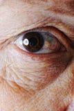 Gammal hud, öga, closeup Arkivfoto