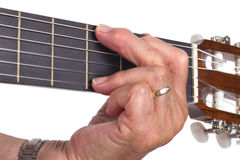 Gammal isolerade hand och gitarr Arkivfoto