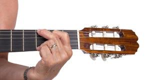 Gammal isolerade hand och gitarr Royaltyfria Bilder