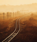 Gammal järnväg på solnedgången Royaltyfri Foto
