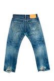 Gammal jeans på isolerad vit Arkivbilder