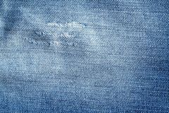 Gammal jeanstextur med skrapor Royaltyfria Bilder