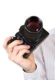 Gammal kamera i en hand Royaltyfri Foto