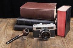 Gammal kamera med röret Arkivbilder