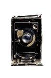 Gammal kamera på den vita bakgrunden Royaltyfri Foto