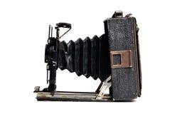 Gammal kamera på den vita bakgrunden Arkivfoton