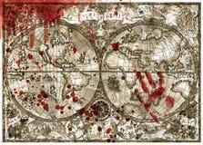 Gammal kartboköversikt av världen med det blodiga handtrycket och droppar Arkivfoto