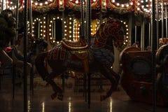 Gammal karusell med hästar och andra diagram royaltyfri foto