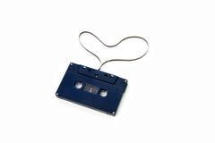 Gammal kassettband och hjärta Fotografering för Bildbyråer