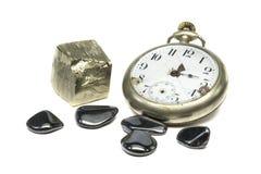 Gammal klocka och pyrit Fotografering för Bildbyråer