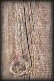 Gammal knuten Wood textur för Vignetted Grungebakgrund Fotografering för Bildbyråer