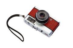 Gammal kompakt filmfotokamera med isolaten för krokodilhudfullföljande Royaltyfria Bilder