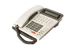 Gammal kontorstelefon som isoleras på vit bakgrund Royaltyfria Foton