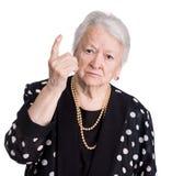 Gammal kvinna i ilsken gest arkivbild