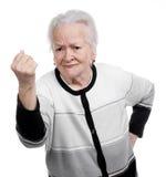 Gammal kvinna i ilsken gest royaltyfri bild
