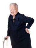 Gammal kvinna som rymmer hennes lägre baksida arkivfoton