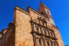 Gammal kyrklig fasad i Chelva, Valencia royaltyfri foto