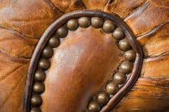 Gammal läderfåtöljdetalj Royaltyfria Foton