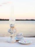 Gammal lampa, rosa solnedgång Royaltyfri Foto