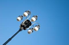 Gammal lamppost i blåttskyen Royaltyfria Foton