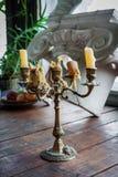 Gammal ljusstake med stearinljus Royaltyfria Bilder