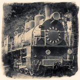 Gammal lokomotiv i retro svartvit design royaltyfri foto