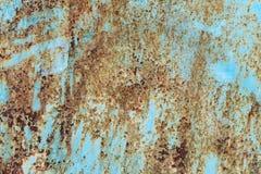 Gammal målad metall som startade att rosta bakgrund Arkivbild
