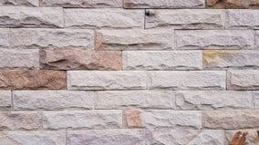 Gammal mönstrad bakgrund för stenvägg Arkivbild