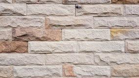 Gammal mönstrad bakgrund för stenvägg Arkivfoto
