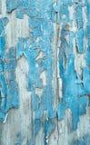Gammal mönstrad träbakgrund i turkos eller blått med flagat arkivbild
