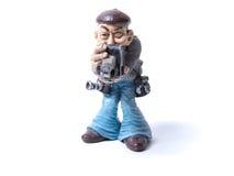 Gammal manlig fotograf för statyett med kameror Royaltyfri Foto