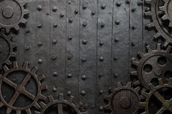 Gammal metallbakgrund med rostiga kugghjul och kuggar Arkivbild
