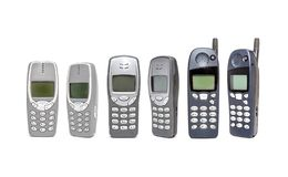 Gammal mobiltelefon på vit bakgrund fotografering för bildbyråer