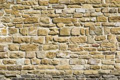 Gammal naturlig stenv?gg, bakgrund, textur eller modell Lantligt texturera V?gg med tegelstenar av italienska stenar arkivbilder