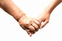 Gammal och ung hand, händer av farmorholdingen gr Royaltyfria Bilder