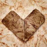 Gammal paper hjärta Arkivfoto
