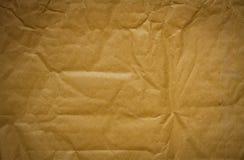 Gammal pappers- bakgrundstextur royaltyfria foton