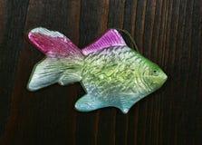 Gammal pappers- julgranleksak av det 18th århundradet i form av en fisk Royaltyfri Fotografi