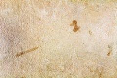 Gammal pappers- textur med fläckar och skrapor abstrakt bakgrund Arkivfoton