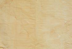 Gammal pappers- textur med vecklinjer arkivbilder